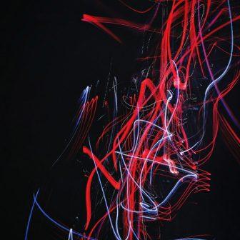 Abstract red blue on black glass splashback